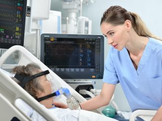 Picture of a respiratory therapist and patient